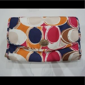 NWT Coach multicolored toiletry bag.